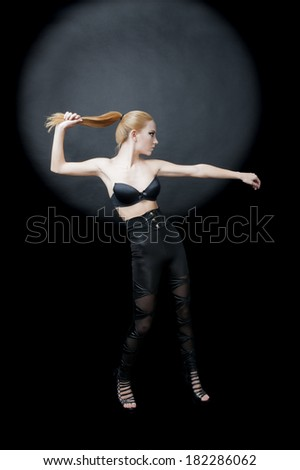 female fashion model wearing black bra high heels black tights blond hair  - stock photo