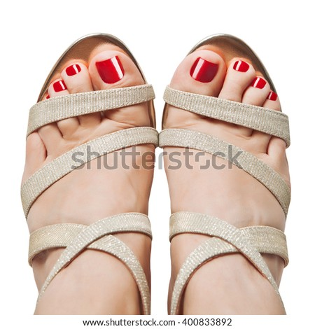 Female feet in sandals. The view from the top. - stock photo