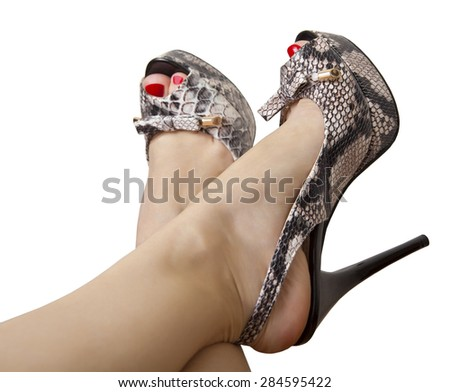 Female feet in sandals with high heels - stock photo