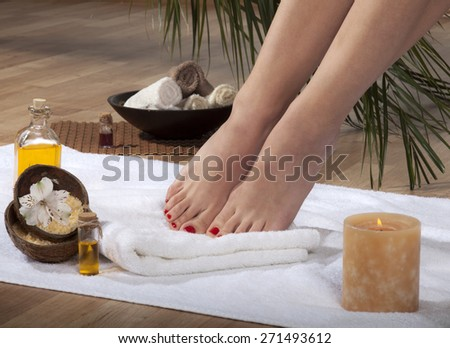 Female feet with drops of water on spa background. - stock photo