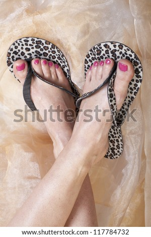 female feet with pink pedicure close up - stock photo