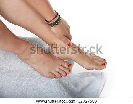 female feet with red toe nails