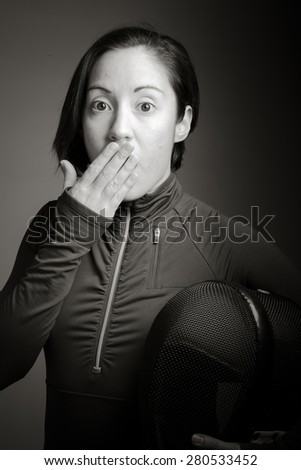 Female fencer hand over her mouth and shock - stock photo