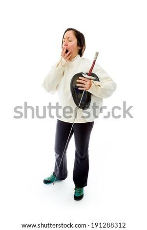Female fencer yawning - stock photo