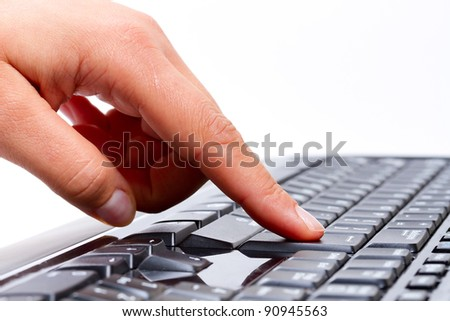 Female finger pressing enter button on the keyboard - stock photo