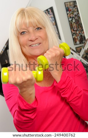 Female Fitness Dumbbells - stock photo