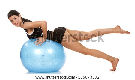 female fitness model exercising with blue ball
