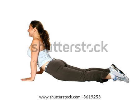 Female fitness trainer, doing back stretch on the floor, isolated on white. - stock photo
