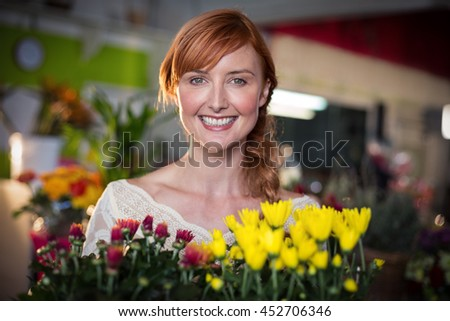 Female florist holding flower bouquet in the flower shop - stock photo
