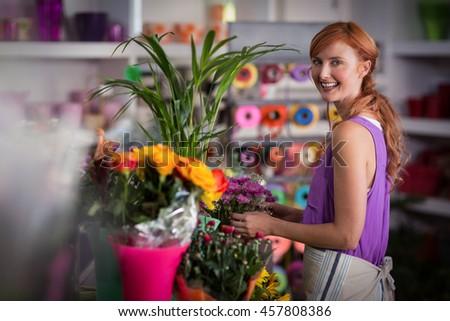 Female florist preparing flower bouquet in the flower shop - stock photo
