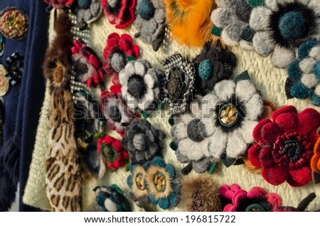 female flower brooches made ??from scraps of materials beads feathers and fur  - stock photo