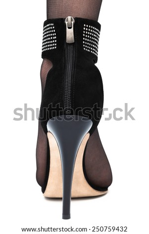 female foot in high-heeled shoe - stock photo