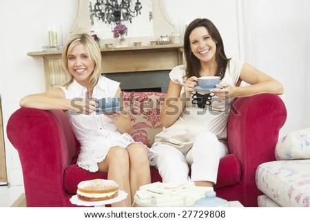 Female Friends Enjoying Tea And Cake At Home - stock photo
