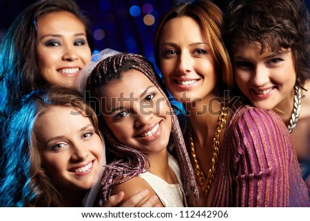 Female friends having fun and enjoying themselves at a bridal party - stock photo