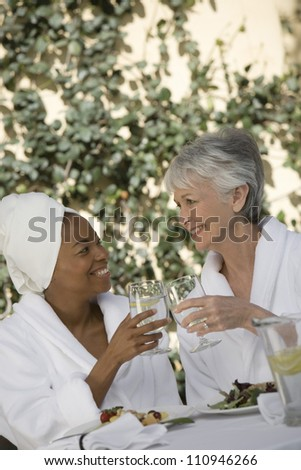 Female friends in bathrobe - stock photo