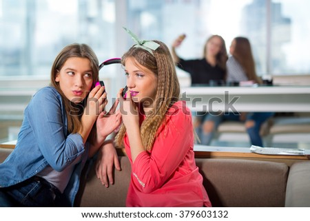Female friends listening to music together, selective focus - stock photo