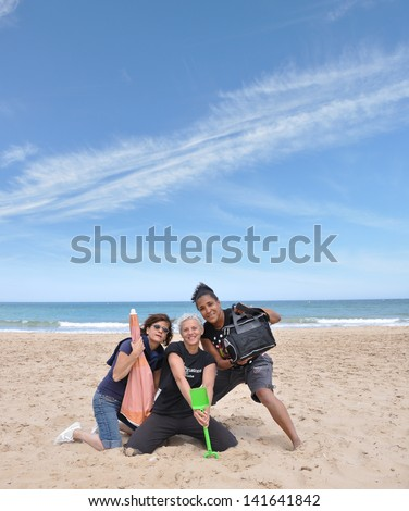 Female Friends on Beach Looking at Camera Smiling Summer Vacation Fun - stock photo
