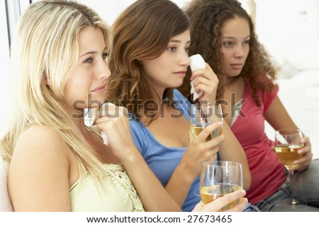 Female Friends Watching A Sad Movie Together - stock photo
