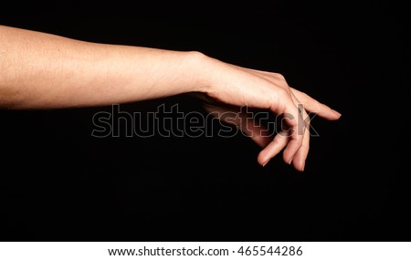 Female gesture hand isolated on black background
