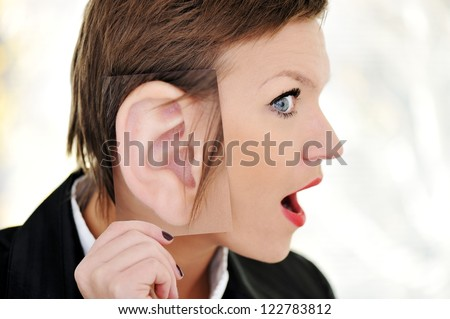 Female giant ear shock concept - stock photo