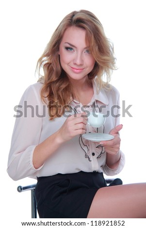 Female girl is holding coffee cup and sitting on a stool - stock photo