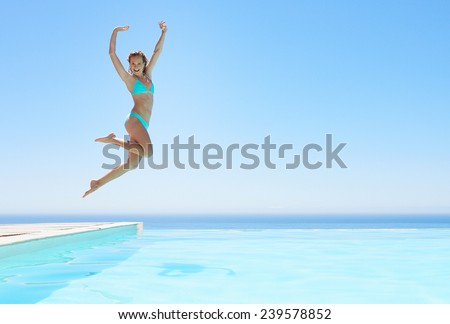 female girl jumping in pool - stock photo