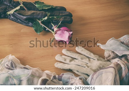 female glove declining the rose from a male glove - stock photo