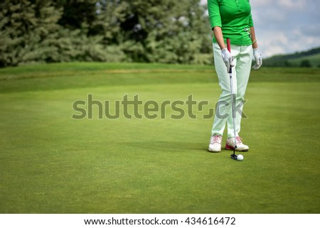 Female golf player - stock photo