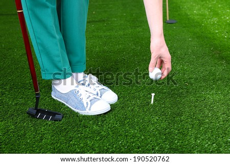 Female golf player at golf course.