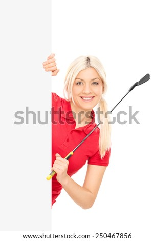 Female golfer posing behind a blank billboard isolated on white background - stock photo