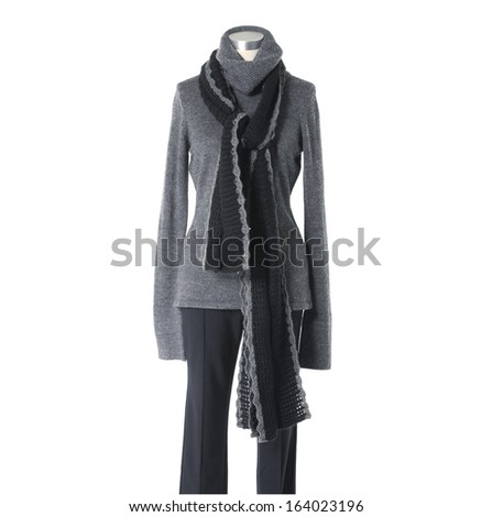 female gray dress with black scarf and trousers isolated on a dummy