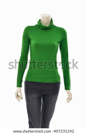 female green clothing in jeans with cap on mannequin  - stock photo