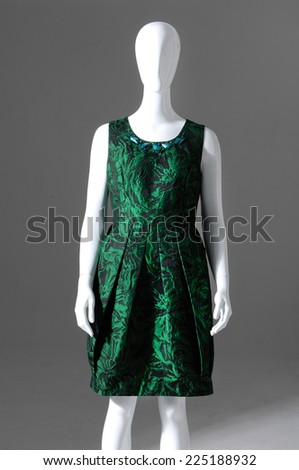 Female green clothing on mannequin isolated-gray background - stock photo