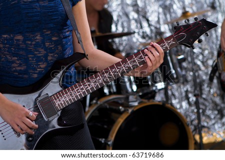 Female guitarist - rock guitar player - stock photo