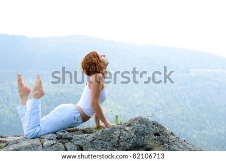 female gymnastics on the cliff edge - stock photo