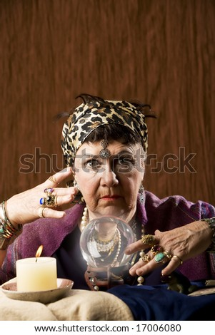 Female gypsy fortune teller with a crystal ball - stock photo