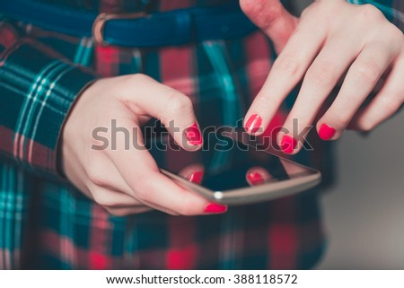 female hand click on the touchscreen smartphone - stock photo
