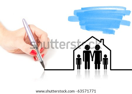 Female hand drawing a house over a family - stock photo