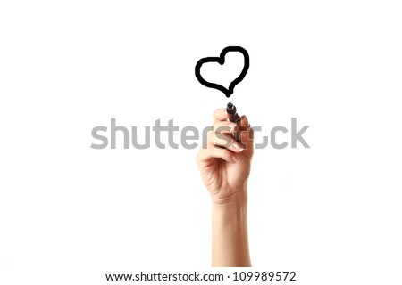 Female hand drawing heart with black marker - stock photo