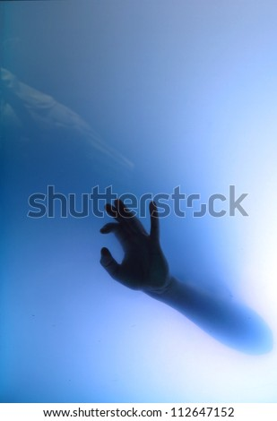Female hand giving handsign ok under water - stock photo