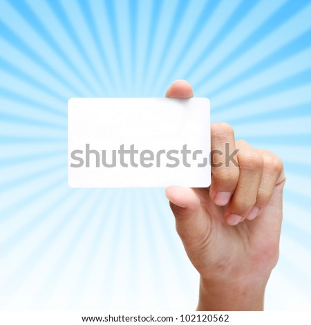 female hand hold card with blue rays background. - stock photo