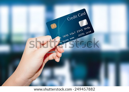 female  hand hold credit card - stock photo