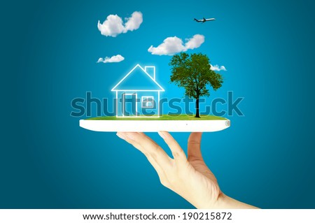 Female Hand hold digital tablet present Nature house or home - stock photo