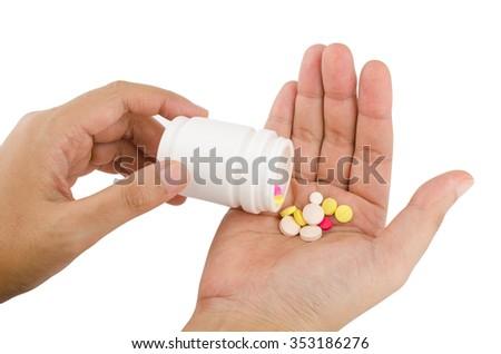 female hand hold many medicine on white background - stock photo
