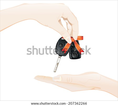 Female hand holding a car key and handing it over to another person.
