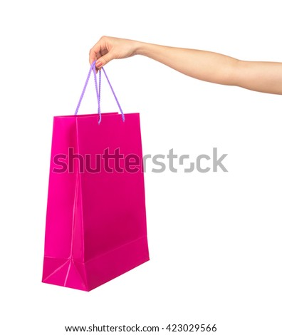 female hand holding a crimson gift bag isolated on white background