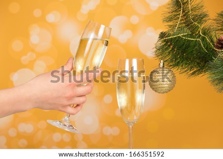Female hand holding a glass of champagne - stock photo
