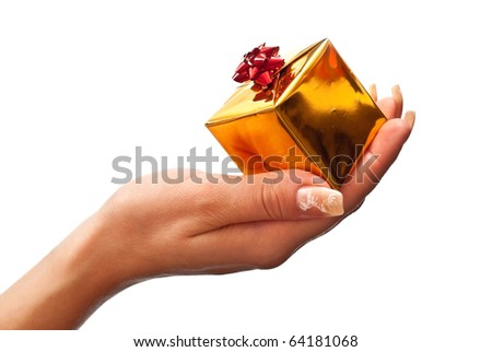 Female hand holding a gold christmas gift. Isolated on white - stock photo