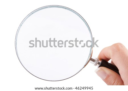 Female hand holding a magnifying glass  isolated against a white background