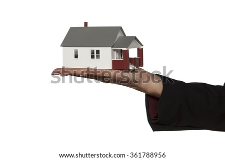 female hand holding a model house